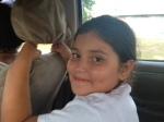 "Maria Inez's granddaughter, riding with us to deliver to ""la viejita.""  She was super cute, and picked up on my beat-boxing lessons pretty fast."