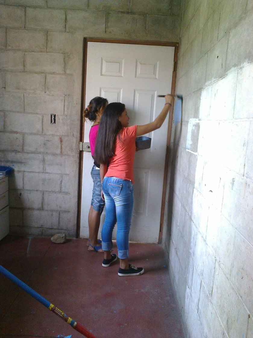 Ana and Gretel starting the paint on those gray brick walls!