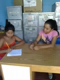 Ana Yanci tutors another child from the community